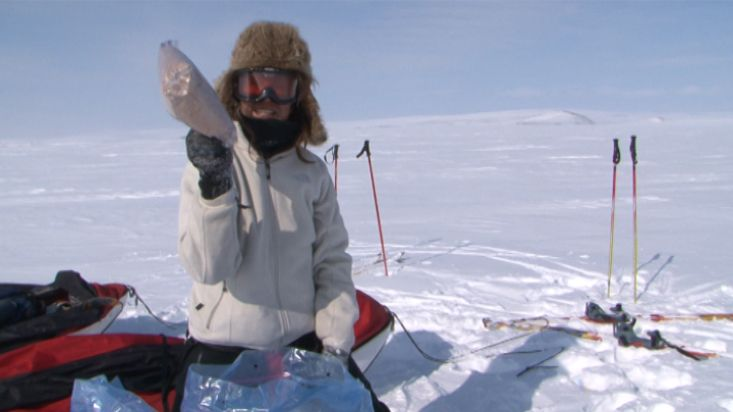 Ingrid unearhting the food of the portage from the snow - Penny Icecap 2009 expedition