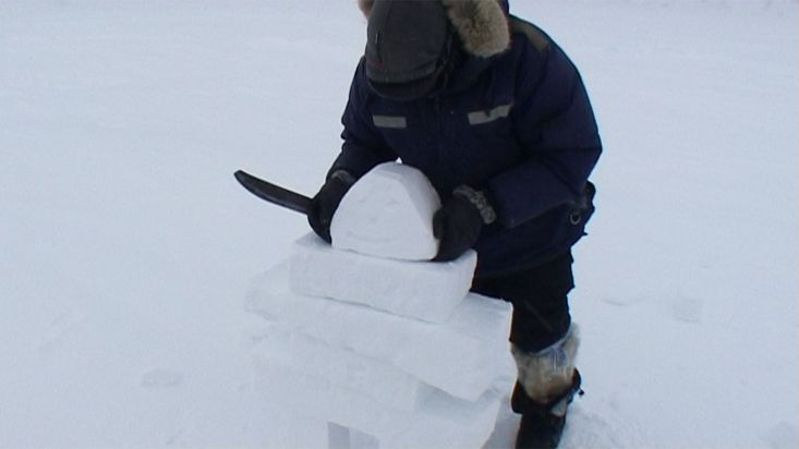 Inuit from Arctic Bay building an
