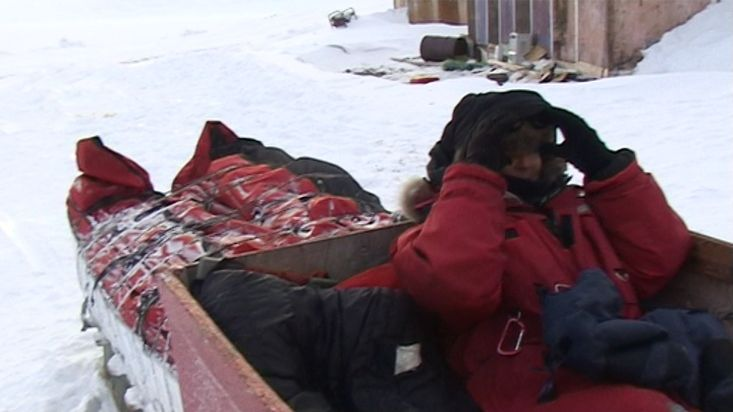 Sitting down on the sled for comeback to Clyde River - Sam Ford Fiord 2010 expedition